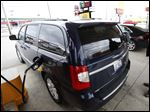 Rich Kriger, from Chicago, pumps gas at the Pilot Travel Center on Libbey Rd and I-280  on his way to Philadelphia for the holiday weekend with his family on November 25, 2014.