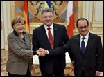 Ukrainian President Petro Poroshenko, center, French President Francois Hollande, right, and German Chancellor Angela Merkel shake hands during their meeting in Kiev, Ukraine, Thursday, Feb. 5, 2015. The leaders of France and Germany were carrying a new peace initiative to the Ukrainian and Russian capitals Thursday, amid a flurry of high-level diplomacy to end what Hollande called a war on Europe's edge. (AP Photo/Presidential Press Service, Mykola Lazarenko)