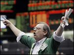 Trader Michael Klemke shouts in the yen futures trading pit at the Chicago Mercantile Exchange, Thursday, December 30, 2004. The dollar fell to a record against the euro and dropped versus the yen after an industry report showed business in the Chicago area, a center of U.S. manufacturing, declined and the region's employment weakened. Photographer: John Gress/Bloomberg News.
