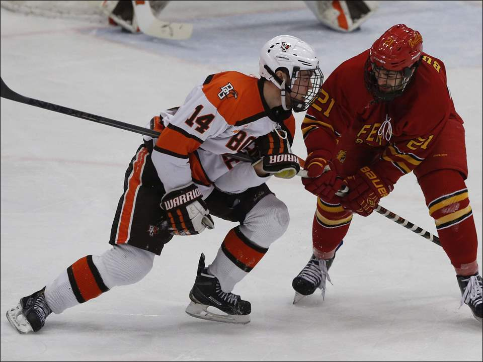 BGSU's Mark Friedman and Ferris State's Justin Buzzeo grab each other's sticks during third period.