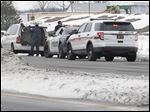 Woodville police officers stop a motorist along U.S. 20 on the east side of the village.