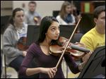 Geeta Rao, 18, said she was hooked on the violin after her mother took her to a performance of the Toledo Symphony at the age of 6. Miss Rao's instructor is Merwin Siu, who is the principal second violinist of the Toledo Symphony. Pamela Thiel, director of orchestra at Northview, described Miss Rao's musical style as one of 'unusual grace and passion.'