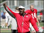 FILE - In this Aug. 16, 2011, photo, Ohio State receivers coach Stan Drayton calls out to players during NCAA college football practice in Columbus, Ohio. As college football moves toward an early signing period for recruits, some of this year's signees learned no matter when you sign that national letter of intent, situations can change the very next day.Mike Weber, a running back from Detroit who signed with Ohio State, tweeted
