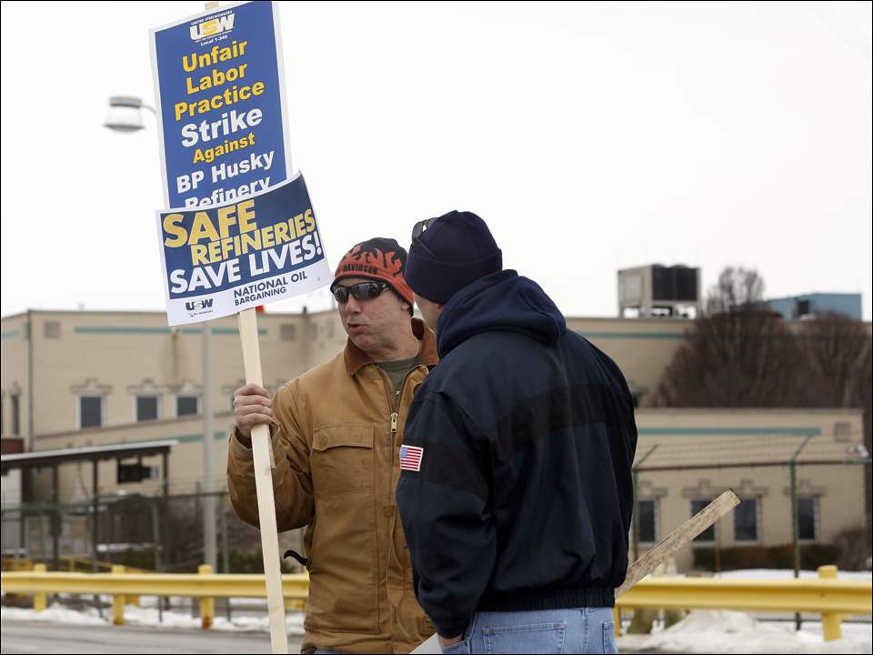 John Clemons,  Special Assistant to the National President of  AMO, left, speaks with BP-Husky Refinery employee Bob Hicks, right, outside of the facility with strikers in Oregon in conjunction with the national effort.