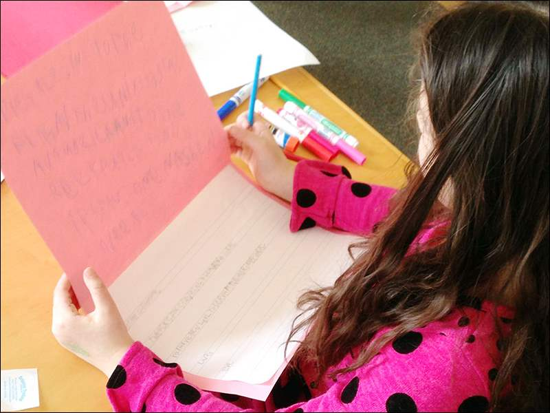 A kindergarten student wrote the Pledge of Allegiance in her valentine to honor the veterans.
