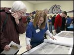 A  NEXUS representative shows a property owner a proposed study corridor map at a public forum at Swanton High School last week.