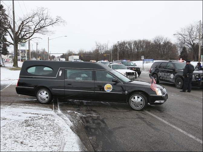The hearse carrying body of Toledo Mayor D. Michael Collins leaves Coyle Funeral Home in South Toledo.