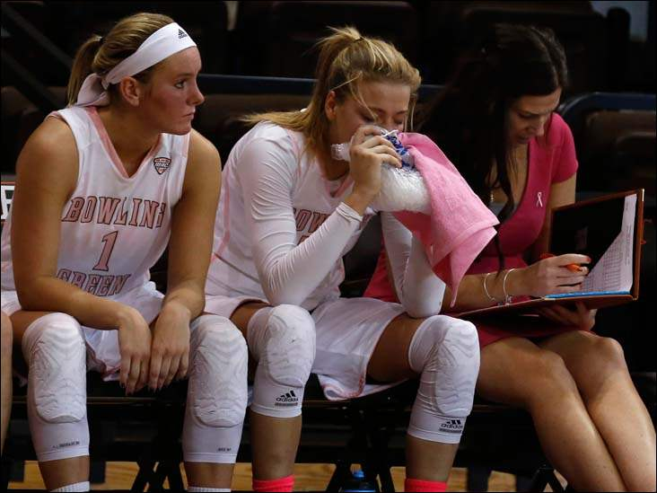 BGSU's Miriam Justinger ices an injury during the final few minutes of the game against Ohio at the Stroh Center. Sitting next to her is Deborah Hoekstra.