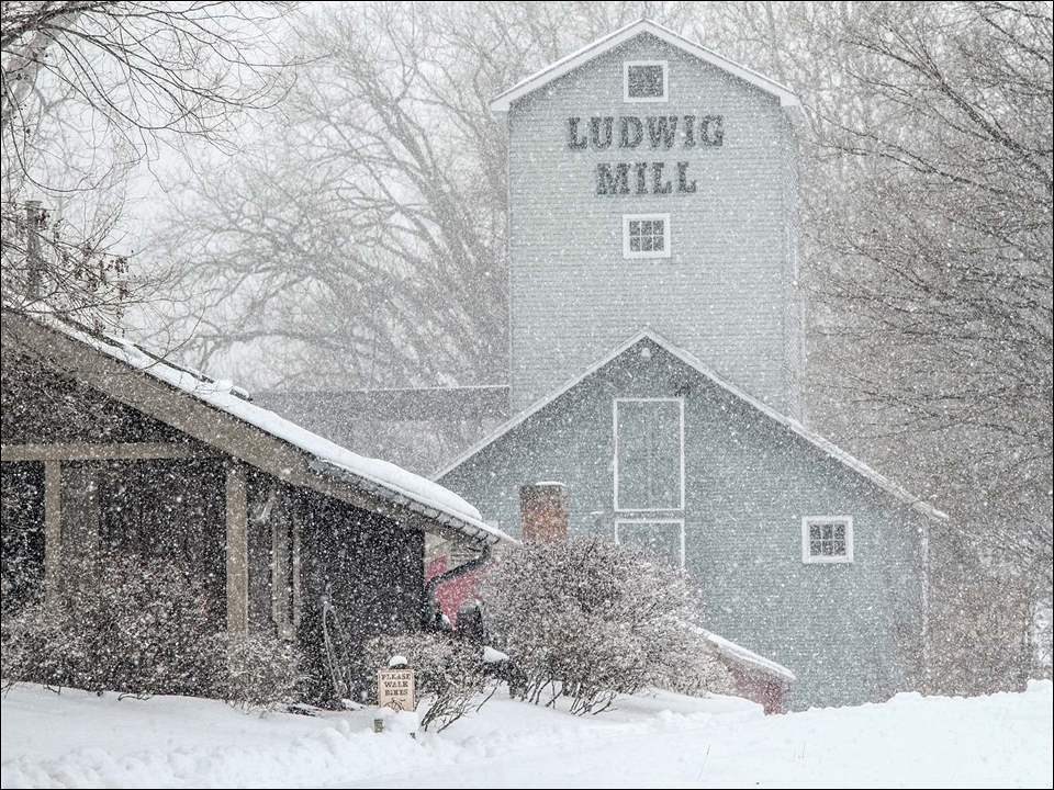 Snow falls fast at the Isaac Ludwig Mill in Grand Rapids.