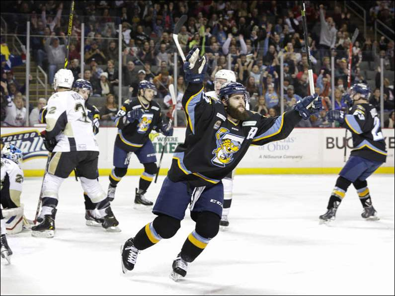 Toledo Walleye player Cody Lampl (32) celebrates his goal against the Wheeling Nailers.