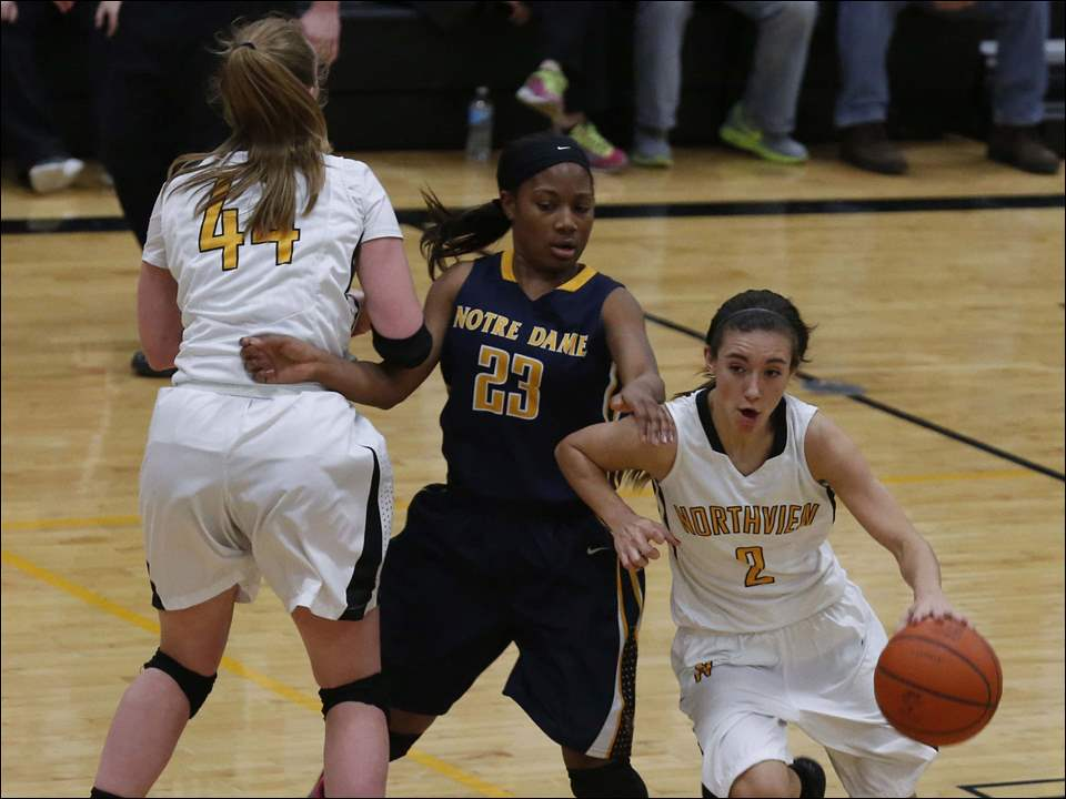 "Northview's Haley Archibeque drives around Notre Dame's Christiana ""CJ"" Jefferson."