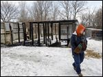 Laura Zitzelberger, operations manager at Nature's Nursery, walks away from what remains of the waterfowl enclosure. All four birds that had been housed inside were rescued.