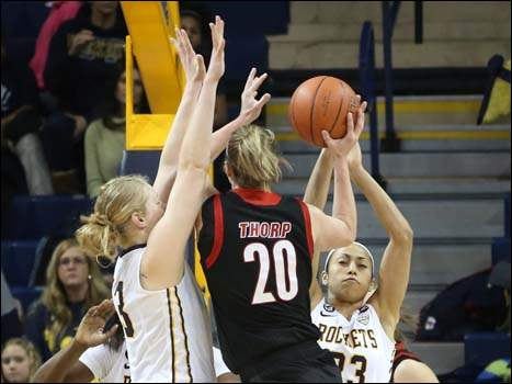Toledo's Inma Zanoguera (23) draws the charging foul from Northern Illinois' Jenna Thorp (20) during the first half.