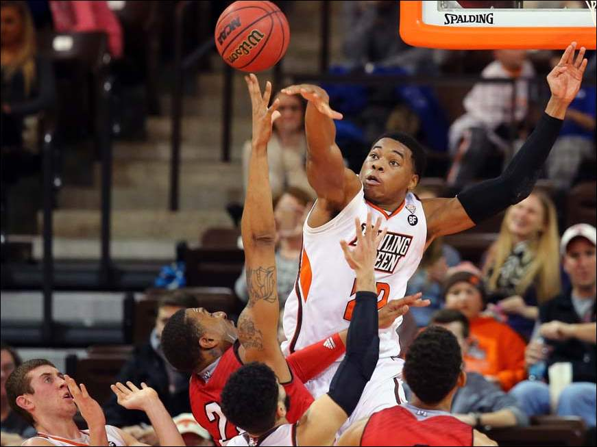 Bowling Green State University forward Richaun Holmes (22) defends against  Miami guard Willie Moore (22.