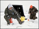 Ice fishermen can best tackle the elements with layers of clothing to ward off the wind and cold, and extra protection for the hands, feet and head.
