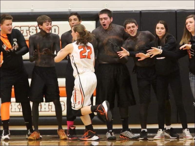 Otsego's student section lines up to cheer on Shannon Weihl (22) before the start of the game.