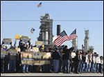 Representatives from the United Steelworkers union rally at the entrance to the Marathon refinery in Catlettsburg, Ky. Eleven sites are affected, including the local plant in Oregon.