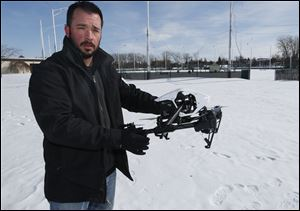Phil Myers holds  a DJI Inspire 1 drone. A recent report predicts that unmanned aerial vehicles will become a $1.7 billion business by 2025.