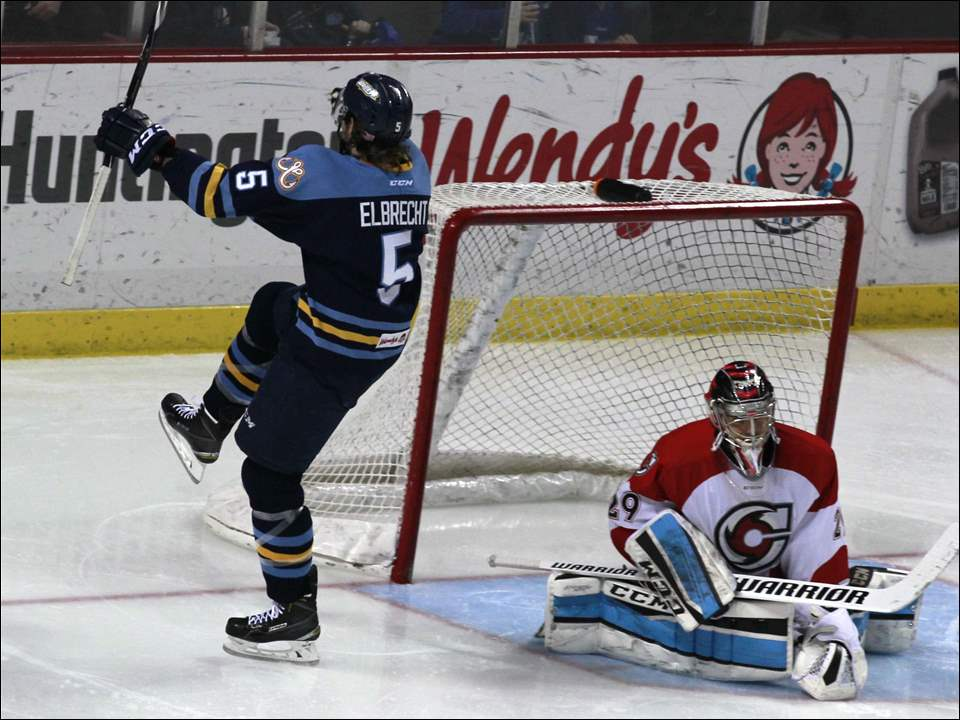 Walleye's Tyler Elbrecht scores against Cincinnati goalie Rob Madore.