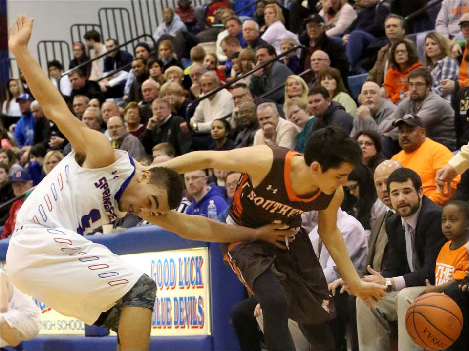 Springfield's Mason Durden (5) fouls Southview's Nate Kalniz (4) during the fourth quarter.