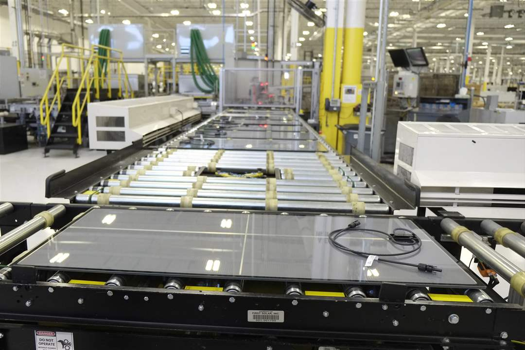 BIZ-SOLAR20pSolar-panels-being-made-at-Firs