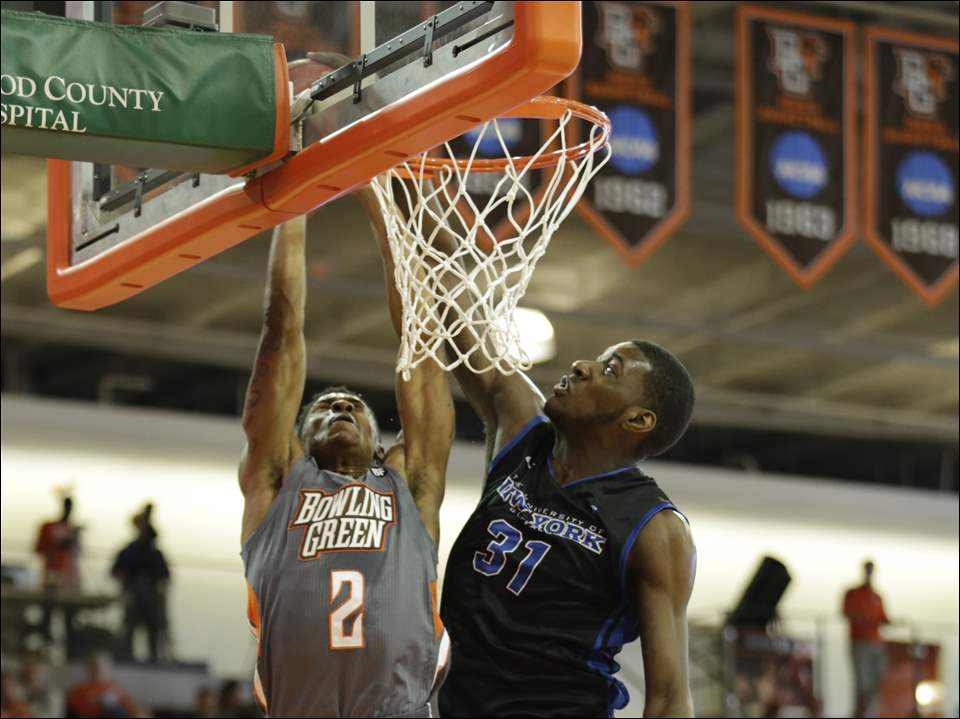 Bowling Green State University player Anthony Henderson (2) has his shot blocked by Buffalo player Raheem Johnson (31)  during the first half of their basketball game at Bowling Green State University, Saturday, February 21, 2015. The Blade/Andy Morrison