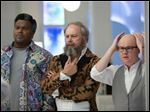 In this image released by Paramount Pictures/MGM, Craig Robinson, from left, Rob Corddry and Clark Duke appear in a scene from