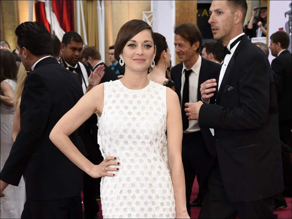 Marion Cotillard arrives at the Oscars.
