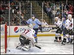 The Walleye score their first goal at 1:25 of the first period on a shot by Troy Schwab, second from right, as Tyler Barnes celebrates.