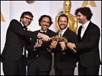 "Nicolas Giacobone, and from left, Alejandro Gonzalez Inarritu, Alexander Dinelaris and Armando Bo pose in the press room with the award for the best picture for ""Birdman."