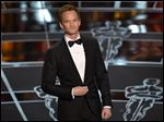 Host Neil Patrick Harris speaks at the Oscars on Sunday at the Dolby Theatre in Los Angeles.