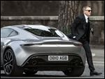 Actor Daniel Craig steps out of a sports car during the shooting of the latest James Bond movie