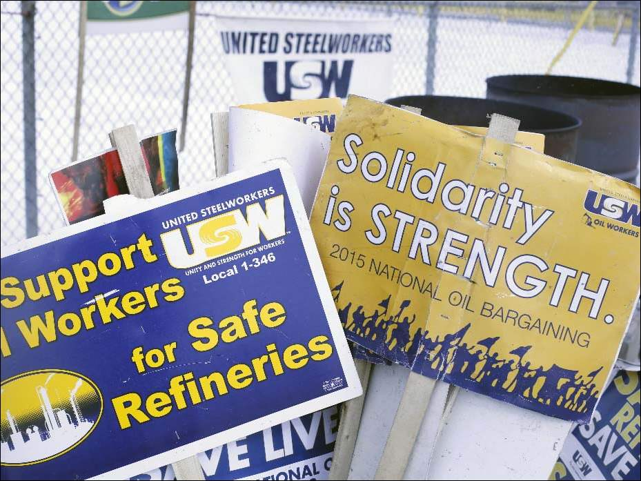 Signs available for picketers outside of the BP-Husky Refinery in Oregon on February 24, 2015.
