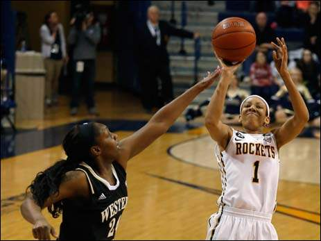 Western Michigan's Miracle Woods guards Toledo's Brenae Harris.