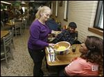 Linda Reese delivers a meatloaf dinner to a customer at the Superior Restaurant in Cleveland.