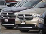 A line of unsold 2012 Durango sports-utility vehicles sits at a Dodge dealership in Littleton, Colo.