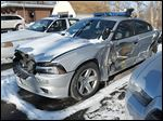 Trooper Stephen Zientek's cruiser was smashed by a tractor-trailer Feb. 20 while Mr. Zientek was pulled over to help motorist Mike Celusta, whose car had stalled on I-475. The two escaped death by jumping over a guardrail.