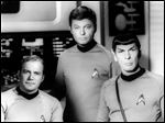 William Shatner, left, DeForest Kelley, center, and Leonard Nimoy pose on the set of the television series 'Star Trek.'