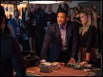 Will Smith and Margot Robbie, right, appear in a scene from