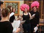 Deena Zucker, 18, center right, and her mother Meira right, preform during practice at B'nai Israel for this year's Purimspiel.