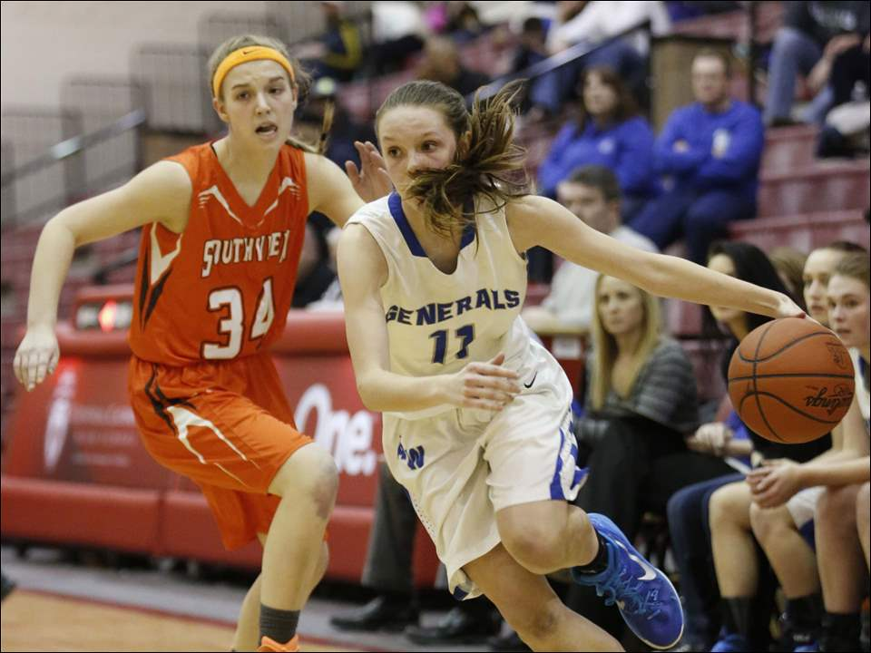 Anthony Wayne player Renee Saneholtz (11) drives around Sylvania Southview player Keely Pohl (34) during the third quarter.
