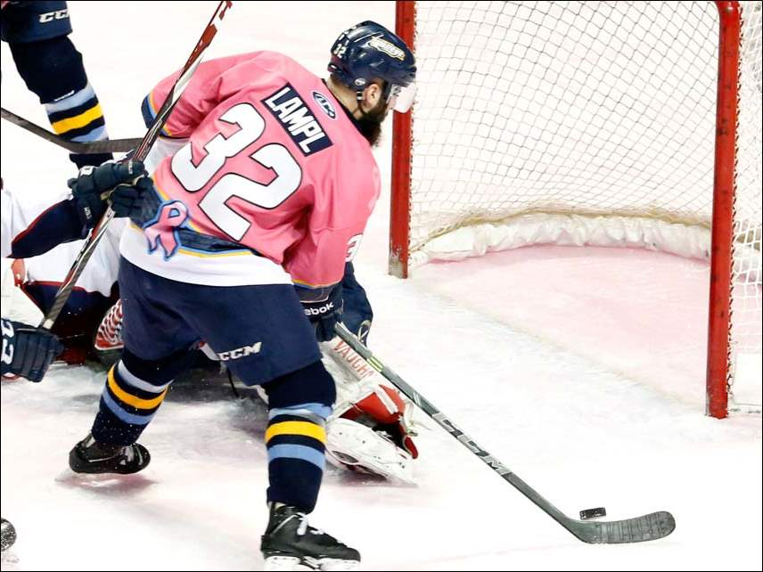 The Toledo Walleye's Cody Lampl scores a goal against the Kalamazoo Wings Sunday.