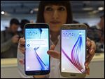 The new Galaxy S6, right, and S6 Edge are displayed during a Samsung Galaxy Unpacked 2015 event on the eve of this week's Mobile World Congress wireless show in Barcelona, Spain, Sunday.