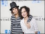 Linda Perry, left, and Sara Gilbert welcomed a son, Rhodes Emilio Gilbert Perry, over the weekend.