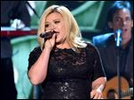 Recording artist Kelly Clarkson performs onstage during the 2014 American Country Countdown Awards at Music City Center in Nashville.