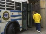 A man who has been released from the Corrections Center of Northwest Ohio leaves the bus outside of the Lucas County Corrections Center in Toledo.