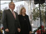 D. Michael Collins and his wife, Sandra Drabik, wait before he takes the oath of office Jan. 2, 2013.