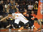 Bowling Green's Richaun Holmes chases a loose ball against Kent State at the Stroh Center.