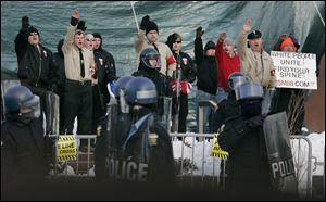 Members of the National Socialist Movement, including Bill White, at center behind a helmeted officer, rally in front of One Government Center on Oct. 25, 2005.