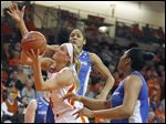 Buffalo's Christa Baccas tries to block Bowling Green's Deborah Hoekstra during Wednesday's game. The senior guard had 12 points and 13 rebounds in the loss.